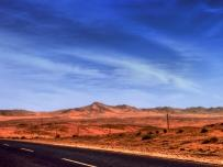 Road in the desert to the wild horses at Aus Namibia