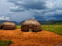 Traditional Zulu huts with the Drakensberg background
